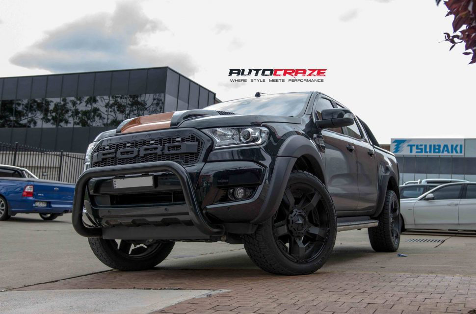 Black Ford Ranger KMC Rockstar XD 2 wheels matte black nitto terra grappler tyres front shot