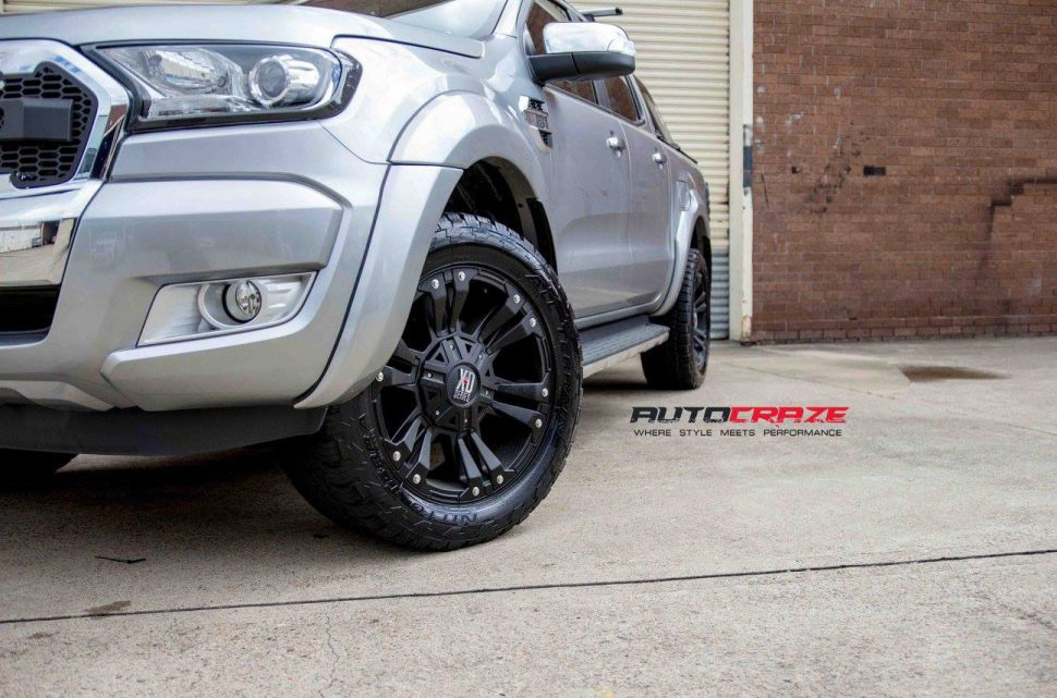 Silver Ford Ranger KMC Monster XD 2 wheels matte black nitto terra grappler tyres close up fitment shot