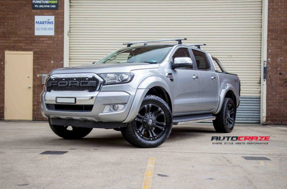 Silver Ford Ranger KMC Monster XD 2 wheels matte black nitto terra grappler tyres front shot