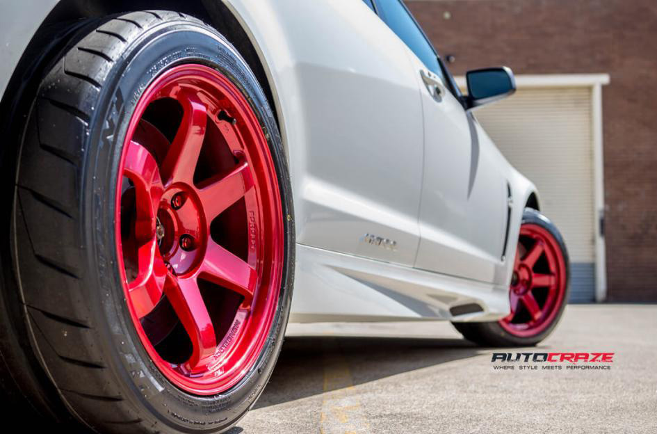 White Holden HSV Maloo Rays TE37SL Hyper Red JDM rims Nitto tyres rear fitment shot