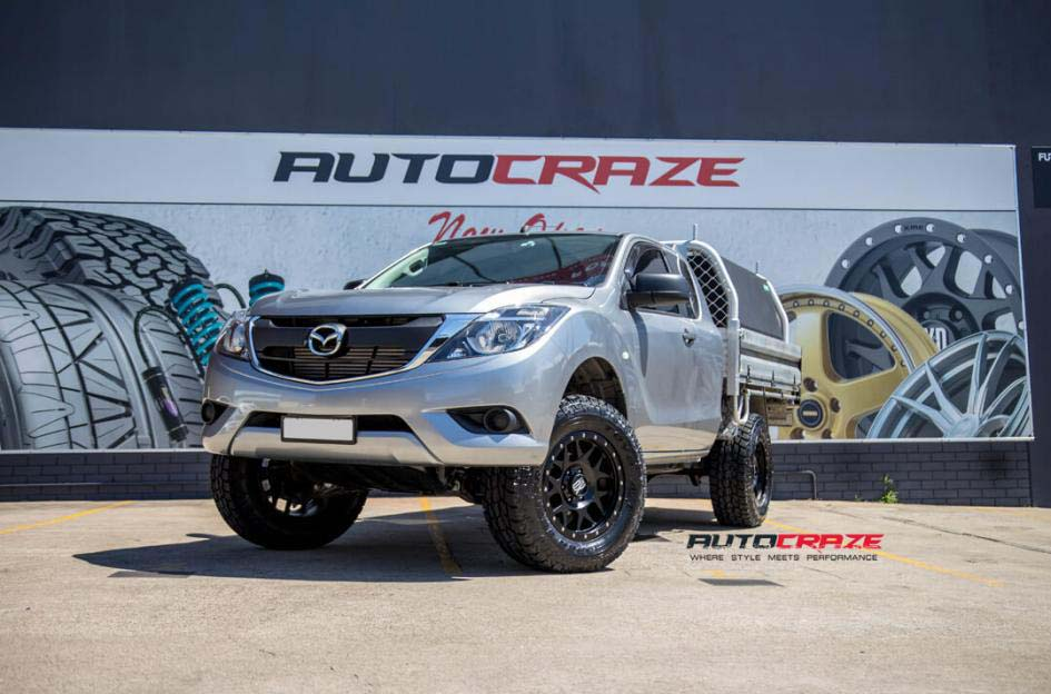 Mazda BT50 KMC Bully alloy wheel toyo open country tyre front wide angle shot january 2018