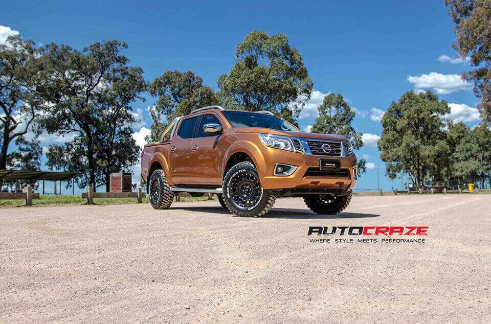 Orange Nissan Navara KMC Holeshot satin black 4wd rims BF Goodrich tyres
