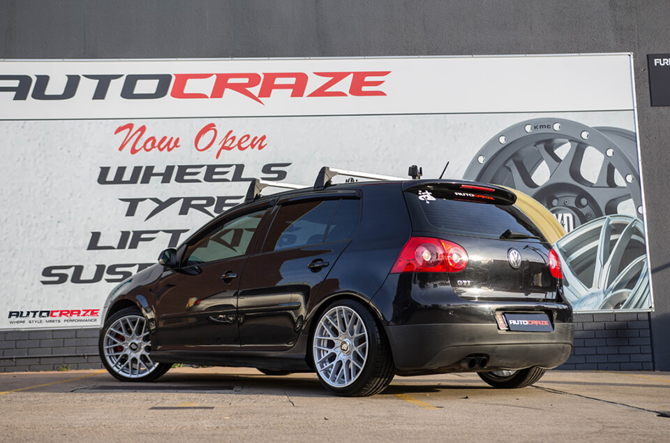 BLACK VOLKSWAGEN GOLF ROTIFORM RSE SILVER WHEELS REAR SHOT