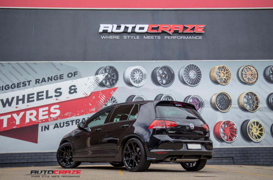 Volkswagen Golf with Rotiform wheels rear wide angle shot febuary 2018