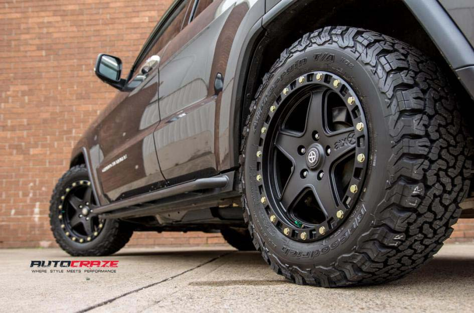 13Jeep Grand Cherokee with American Racing ATX Ravine Wheels and BF Goodrich Tyre Rear Fitment Close Up Shot Janurary 2018_large