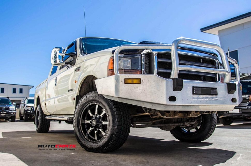 White Ford F250 with Moto Metal MO970 Gloss Black Machined Face Wheels front shot