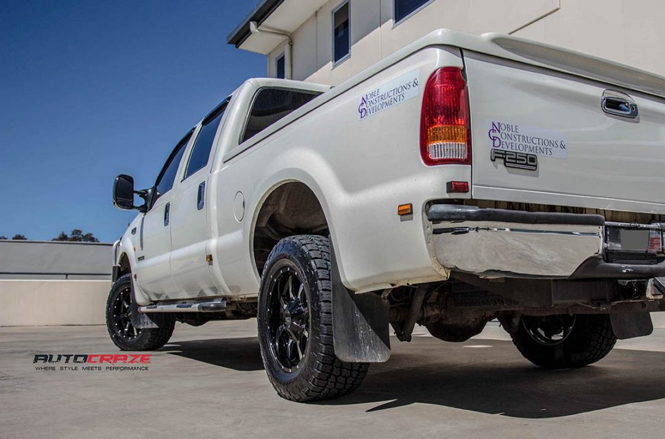White Ford F250 with Moto Metal MO970 Gloss Black Machined Face Wheels rear shot