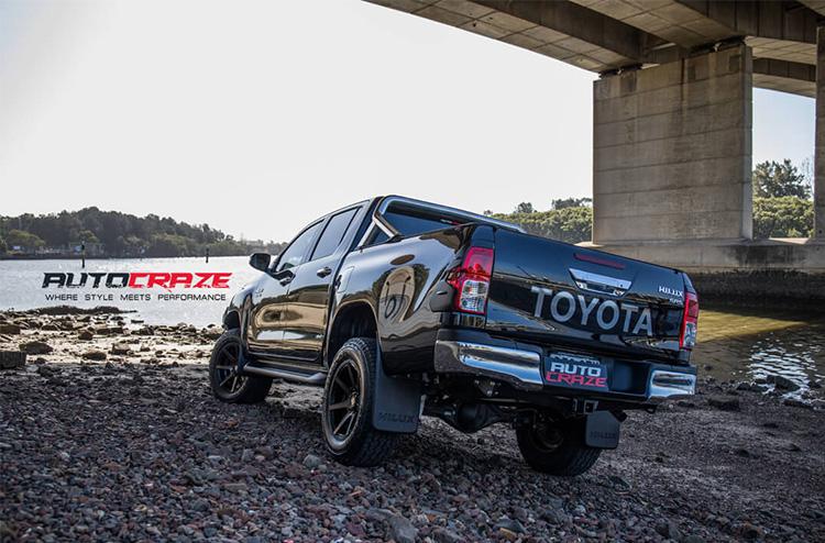 Toyota Hilux back shot. Features Diesel Avalanche Wheels, HSP Roll-R-Cover and Rival Bar.